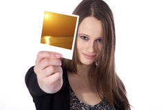 Woman holding a picture in her hand Stock Photos