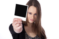 Woman holding a picture in her hand Stock Photography