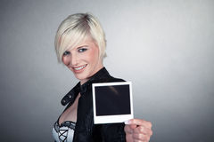 Woman holding a picture Stock Photography