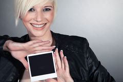 Woman holding a picture Royalty Free Stock Photography