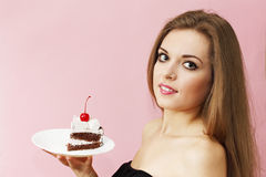 Woman holding a piece of  cake Stock Photo