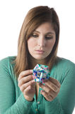 Woman holding a piece of  origami Stock Photos
