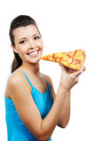 Woman holding piece of pizza Stock Image