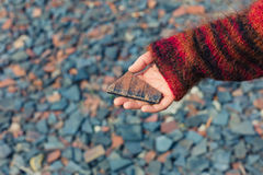 Woman holding a piece of slate Royalty Free Stock Image