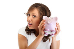 Woman holding pig money-box Stock Photo