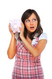 Woman holding pig money-box Royalty Free Stock Images