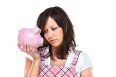 Woman holding pig money-box Stock Image