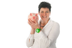 Woman is holding piggy bank. Young woman is holding a big piggy bank Royalty Free Stock Photos