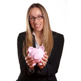 Woman holding a piggy bank Royalty Free Stock Image