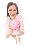 Woman holding piggy bank Stock Photos