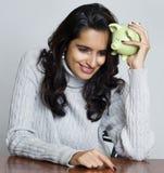 Woman holding piggy bank royalty free stock photos