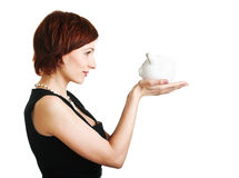 Woman holding piggy bank against white background Stock Photo