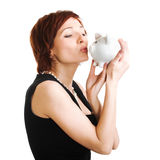Woman holding piggy bank against white background Stock Image