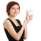 Woman holding piggy bank against white background Royalty Free Stock Images