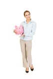 Woman holding piggy bank. Stock Photos
