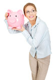 Woman holding piggy bank. Royalty Free Stock Photography