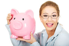 Woman holding piggy bank. Royalty Free Stock Photos