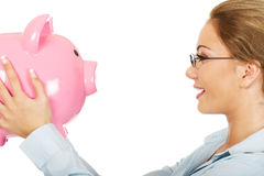 Woman holding piggy bank. Royalty Free Stock Photo