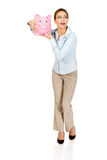 Woman holding piggy bank. Royalty Free Stock Images