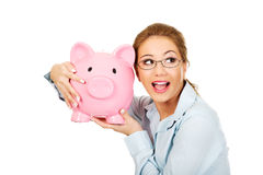 Woman holding piggy bank. Royalty Free Stock Photo