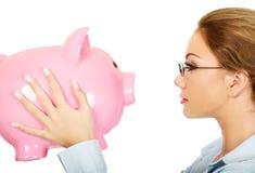 Woman holding piggy bank. Stock Image