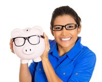Woman holding piggy bank, both with glasses Stock Photography