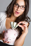 Woman Holding Piggy Bank. Business woman taking money from piggy bank Stock Image