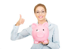Woman holding piggy bank. Stock Photo