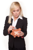 Woman holding piggy bank with a plaster Royalty Free Stock Image