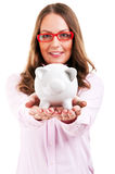 Woman holding piggy bank. Savings and banking concept with happy businesswoman smiling woman holding pink piggy bank on the palm of her hand conceptual of Stock Photography