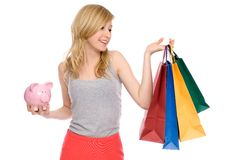 Woman holding piggy bank and shopping bags Stock Photo