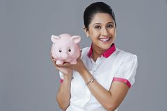 Woman holding piggy bank Stock Image