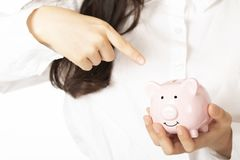 Woman holding a piggy bank on white background royalty free stock images