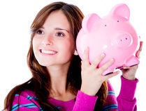 Woman holding a piggybank Stock Photography