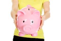Woman holding piggybank. Stock Photography