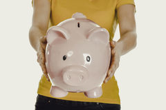 Woman holding piggybank. Royalty Free Stock Photography