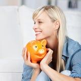 Woman holding piggybank Royalty Free Stock Images