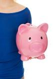 Woman holding piggybank. Royalty Free Stock Photos