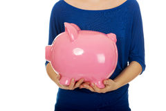 Woman holding piggybank. Royalty Free Stock Photography