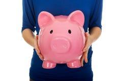 Woman holding piggybank. Stock Images