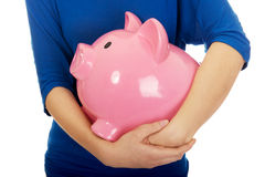 Woman holding piggybank. Stock Images
