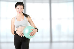 Woman Holding a Pilates Ball Stock Photography