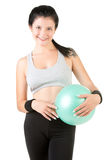 Woman Holding a Pilates Ball Stock Photos