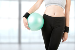 Woman Holding Pilates Ball Stock Photo