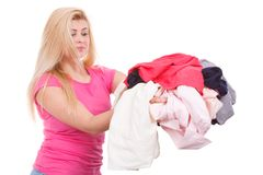 Woman holding pile of creased clothes Stock Images