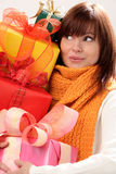 Woman holding pile of gifts Stock Photo
