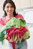 Woman Holding Pile Of Laundry Stock Photos