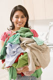 Woman Holding Pile Of Laundry Royalty Free Stock Photo