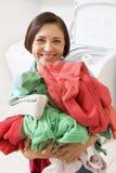 Woman Holding Pile Of Laundry Stock Image
