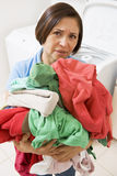 Woman Holding Pile Of Laundry Royalty Free Stock Photos